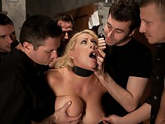 Candy Manson is helplessly bound in duct tape by a gang of dudes then made to made to suck cock and fuck on a dirty bathroom floor.