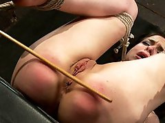 Bound in a pile driver posiiton, Isis Love completely Dominates helpless Juliette with an unforgiving caning, flogging, finger banging, and strap on.