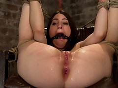 Tiny 5'0 100lb girl with mouth spread open in the ultimate fuck me position. Has her tiny feet caned hard, made to squirt and cum over and over.