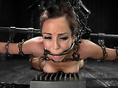 Tough as nails Bryn Blayne is suspended in a chain only hogtie, leather strap ebi suspension, and railed hard in pile driver in metal shackles.
