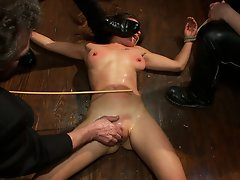 Local amateur model gets tied up, fisted, and fucked by multiple people till she squirts all over the floor