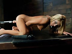 Hot, tanned, big titted blonde girl, fucked with machines until every last orgasm is pulled from her pussy and clit. She rides the Sybian to exhaustio