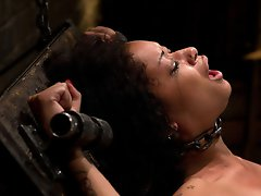 Fetish model Skin Diamond is pushed to her limits. Hard lashings while riding the wedge. Zippered to fuckall and made to cum into submission.
