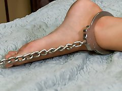 Cassandra Nix stars in her first gangbang where she is handcuffed to a bed and used by a house full of frat boys.