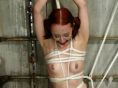 Petite redhead is dominated by latex-clad beauty