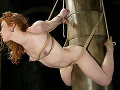 Hot redhead gets sprayed, dunked and vibed