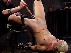 Lorelei Lei is debased in strenuous metal bondage. Her pussy and feet are tormented with weights and clothespins until she begs to stop.