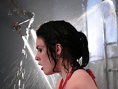Sexy, glamorous brunette is bound sprayed and dunked.