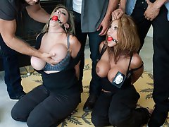 Two female cops are captured by thugs and sexually dominated and fucked.