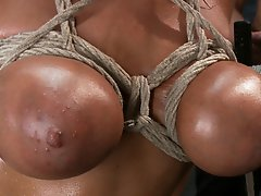 Natural hottie with GIANT tits is bound tightly in rope, stuffed airtight, and filled with cum. Breast bondage, double penetration, creampie, gangbang