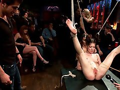 Hot little slut is suspended in the air and fucked by multiple men at a party. Hardcore sex in bondage and public humiliation.