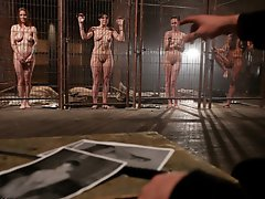 Caged in an abandoned warehouse four slaves are awaiting the arrival of a trainer to take one of them away for his own personal use.