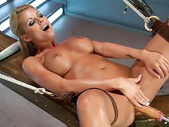 Blonde babe with smoking hot tight body gets spread and nailed by The Bunny Fucker, Doctor Thumper and then her clit buzed to the moon on the Sybian.