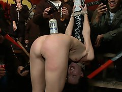 Hot girl gets tied up and exposed at a bar where patrons cover her in beer and spit before watching her get fucked hard.