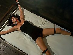 Helpless girl fucked in bondage with gimp and master.