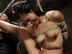 Flexible girl in tight bondage with suspension and dominating sex.